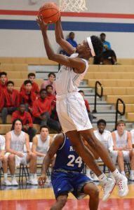 Oak Ridge's Darius Love grabs a rebound during the CE King at Oak Ridge boys basketball game.