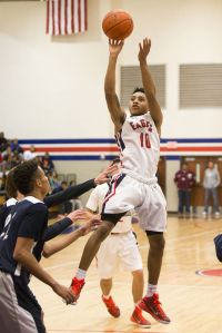 Atascocita's Greg Shead (10) shoots a fadeaway during Atascocita's 82-56 victory over College Park on Jan. 2, 2014, at Atascocita High School.