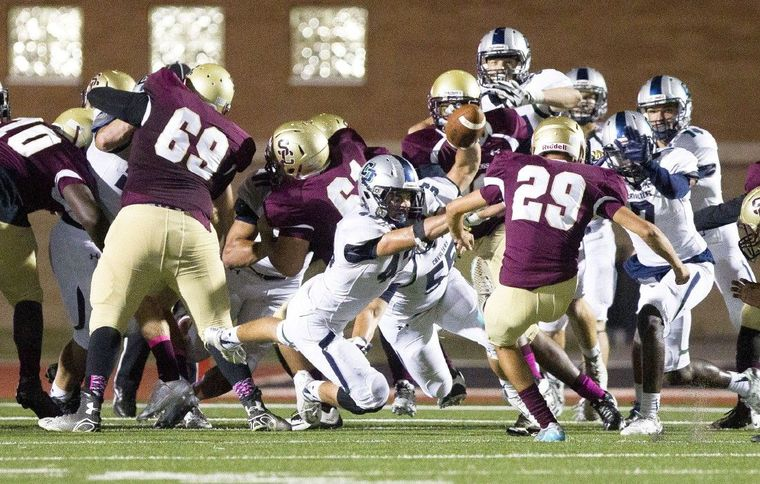 College Park linebacker Sean Milligan tries to block a extra point by Summer Creek kicker Jake Dominque during a District 16-6A football game October 22, 2015, in Humble.