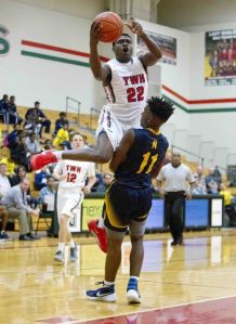 Romello Wilbert, of The Woodlands, goes up for a shot as guard Darrell Braxton, of Nimitz, defends during the first half of a boys basketball game Tuesday, Dec. 8, 2015, in The Woodlands.