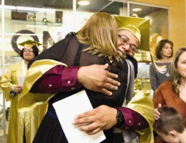 Conroe's Jason Contreras gets a hug before the mid-year commencement ceremony at Conroe High School Thursda