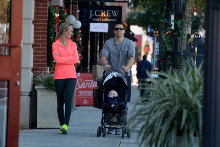 Kimberly Bonilla, from left, and her husband Will, of Spring, stroll with their son Brady, 10 months, in Market Street in The Woodlands on Dec. 4, 2015.