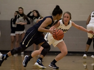 Conroe's Logan Magee defends College Park's Jordan Rockins as they faced each other Tuesday, December 15.