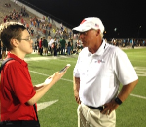 Joe Weaver interviews TWHS head football coach Mark Schmid after a game