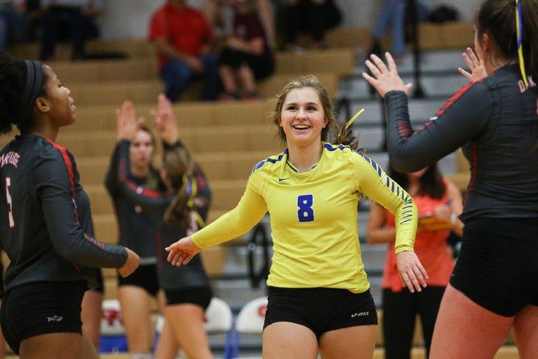 Oak Ridge's Raigen Cianciulli (8) celebrates with teammates during the high school volleyball game against Klein in November at Oak Ridge High School.