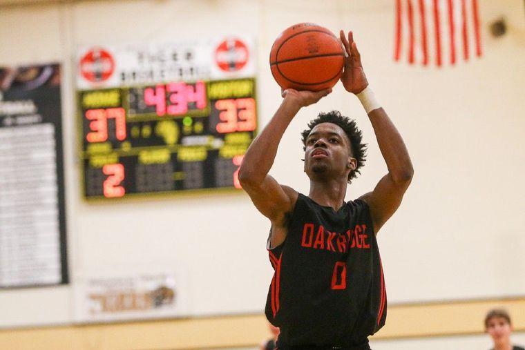 Oak Ridge's Darius Love (0) shoots a free-throw during the high school boys basketball game against Oak Ridge on Tuesday, Jan. 5, 2016, at Conroe High School.