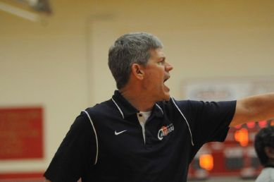 College Park coach Clifton McNeely directs his team against Summer Creek at Caney Creek High School on Friday.