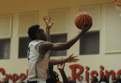 College Park's McKinley Green goes up for a layup against Summer Creek at Caney Creek High School on Friday.
