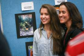 The Woodlands student Kristyn Hauser, who won best of show for her artwork, poses for a photo with her mother Kathy during the Conroe ISD Western Art Show on Saturday, Jan. 7, 2017, at Oak Ridge 9th Grade